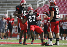 Scott Sommerdorf  |  The Salt Lake Tribune              Former Alta High player Tyron Morris-Edwards, #27, gets congratulated by team mates after he intercepted a pass thrown by QB Jon Hays during Utah football practice, Saturday, August 18, 2012.