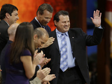 U.S. 1980 Olympic hockey team captain Mike Eruzione is introduced along with other Olympians during the Republican National Convention in Tampa, Fla., on Thursday, Aug. 30, 2012. (AP Photo/Charlie Neibergall)