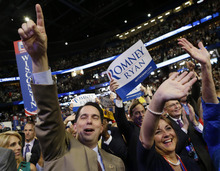 Wisconsin Gov. Scott Walker and his wife Tonette cheer as Republican vice presidential nominee, Rep. Paul Ryan addresses the Republican National Convention in Tampa, Fla., on Wednesday, Aug. 29, 2012. (AP Photo/David Goldman)