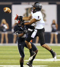Southern Utah wide receiver Fatu Moala (8) catches a pass as Utah State cornerback Quinton Byrd defends during their NCAA college football game, Thursday, Aug. 30, 2012, in Logan, Utah. (AP Photo/The Herald Journal, Eli Lucero)
