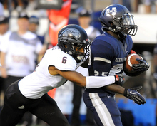 Utah State running back Kerwynn Williams breaks an attempted tackle by Southern Utah defensive back Tyree Mills (6) during their NCAA college football game, Thursday, Aug. 30, 2012, in Logan, Utah. (AP Photo/The Herald Journal, Eli Lucero)