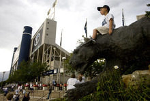 Kim Raff | The Salt Lake Tribune Isaac Allen sits on top of the cougar statue outside of Lavell Edwards stadium before the BYU and Washington State home opener in Provo on Aug. 30, 2012.