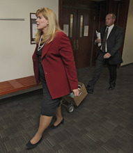Assistant District Attorney Karen Pearson leads the prosecution team into court for a motions hearing for suspected theater shooter James Holmes in district court in Centennial, Colo., on Thursday, Aug. 30, 2012. Holmes has been charged in the shooting at the Aurora theater on July 20 that killed twelve people and injured more than 50. (AP Photo/Barry Gutierrez)