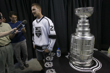 Francisco Kjolseth  |  The Salt Lake Tribune Trevor Lewis, who played hockey for Brighton High School, speaks with the media as he brings the Stanley Cup home for a day as a member of the NHL champion Los Angeles Kings. Thousands of fans lined up at the Maverik Center in West Valley City on Thursday, August 30, 2012, for a chance to pose for a picture with Lewis and the Cup.