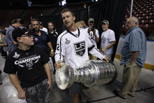 Francisco Kjolseth  |  The Salt Lake Tribune Trevor Lewis, who played hockey for Brighton High School, brings the Stanley Cup home for a day as a member of the NHL champion Los Angeles Kings. Thousands of fans lined up at the Maverik Center in West Valley City on Thursday, August 30, 2012, for a chance to pose for a picture with Lewis and the Cup.