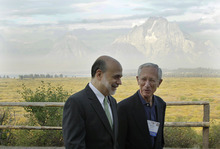 (AP Photo/Ted S. Warren) With the Grand Tetons as a backdrop, Federal Reserve Chairman Ben Bernanke, left, and Bank of Israel Governor Stanley Fischer chat Friday outside of the Jackson Hole Economic Symposium in Wyoming.