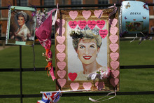 Tributes for Princess Diana are displayed on the gate of Kensington Palace in London on the 15th anniversary of her death, Friday, Aug. 31, 2012. Princess Diana was killed in a car accident in Paris in 1997. (AP Photo/Sang Tan)