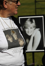 A supporter wearing a t-shirt with image of  Princess Diana with Prince William and Prince Harry looks on at Kensington Palace in London on the 15th anniversary of her death, Friday, Aug. 31, 2012. Princess Diana was killed in a car accident in Paris in 1997. (AP Photo/Sang Tan)