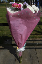 A flora tribute with a message is seen left for Princess Diana on the gate of Kensington Palace in London on the 15th anniversary of her death, Friday, Aug. 31, 2012. Princess Diana was killed in a car accident in Paris in 1997. (AP Photo/Sang Tan)