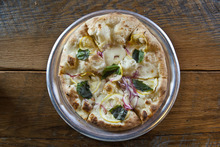 Chris Detrick  |  The Salt Lake Tribune Limone Pizza ($8.95) made with olive oil, mozzarella, parmigiano reggiano, lemons, red onions, garlic and basil at Pizzeria Limone in Cottonwood Heights.