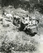 This horse-drawn railroad carried guests and their baggage to and from a resort hotel believed to have been at Alta, Utah in 1904. Summer was the most popular time to visit Alta. The trunk on the back of the car is for clothes. A mule was used to pull the car up and a horse was faster for the way down.