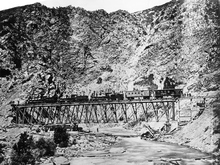 Union Pacific train on the Devil's Gate Bridge in Weber Canyon around 1870.