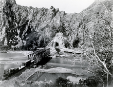 A train emerging on the Eastern side of a tunnel in Weber Canyon East of Morgan in 1869.