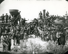 East and West shaking hands at the driving of the last spike completing the transcontinental railroad in Promontory, Utah, 1869.