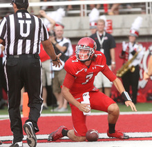 Utah quarterback Travis Wilson, right, reacts in the end zone after scoring a touchdown against Northern Colorado during an NCAA college football game on Thursday, Aug. 30, 2012, in Salt Lake City. (AP Photo/The Salt Lake Tribune, Paul Fraughton)