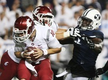 Kim Raff | The Salt Lake Tribune Washington State Cougars quarterback Jeff Tuel (10) scrambles in the back field during BYU's home opener at LaVell Edwards Stadium in Provo on Aug. 30, 2012.
