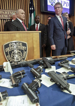 FILE - In this file photo of  July 26, 2012, New York Police Department Commissioner Raymond Kelly, left, and Manhattan District Attorney Cyrus Vance, Jr., and other law enforcement officials leave a press conference where confiscated, illegal firearms were on display, in New York. While recent shootings at a Colorado movie theater, a Sikh temple and outside the Empire State Building have grabbed headlines, residents of inner-city neighborhoods wracked by gun violence say they feel neglected and ignored in this presidential election year- especially as a Democratic Party that used to push for gun control remains largely silent on the issue while Republicans launch a full-throated defense of gun ownership. (AP Photo/Bebeto Matthews, File)