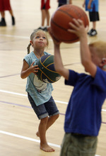 Francisco Kjolseth  |  The Salt Lake Tribune Aubryn Jones, 4, of Croyden eyes her chances at reaching the baskte as Jazz forward DeMarre Carroll participated in Junior Jazz at the Trojan Century Center in Morgan, Utah on Monday, August 6, 2012. Dozens of boys and girls from all age groups had a chance to learn about the 6'8