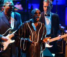 FILE - In this March 18, 2002 file photo, singer Isaac Hayes, center, performs during the opening of the Rock and Roll Hall of Fame inductee ceremony at New York's Waldorf Astoria. Hayes was among the 2002 class of inductees into the hall of fame. Hal David, the stylish, heartfelt lyricist who teamed with Burt Bacharach on dozens of timeless songs for movies, television and a variety of recording artists in the 1960s and beyond, died Saturday, Sept. 1, 2012. He was 91. David wrote the lyrics for a song Hayes performed with Dionne Warwick entitled