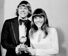 FILE - In this March 17, 1971 file photo, The Carpenters: Richard and Karen, pose with their Grammy during the 13th annual 1970 Grammy Awards in Los Angeles.  The brother-sister duo was named best new artist of the year, 1970, and also won as the best contemporary duo or group vocalists for