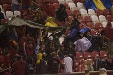 Kim Raff   The Salt Lake Tribune Fans brave a thunder shower that delayed the Real Salt Lake and D.C. United game at Rio Tinto Stadium in Sandy, Utah on September 1, 2012.