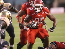 Paul Fraughton | The Salt Lake Tribune Utah running back Jarrell Oliver runs the ball for a short gain to the four-yard line against Northern Colorado at Rice Eccles Stadium in Salt Lake City on Thursday, Aug. 30, 2012.