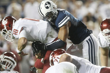 Chris Detrick  |  The Salt Lake Tribune Brigham Young Cougars linebacker Kyle Van Noy (3) sacks Washington State Cougars quarterback Jeff Tuel (10) during the first half of the game against Washington State at LaVell Edwards Stadium Thursday August 30, 2012. BYU is winning the game 24-6.
