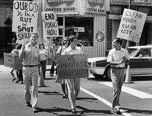 FILE - In this August 8, 1977 photo, followers of the Rev. Sun Myung Moon of the Unification Church, protest pornography in Norfolk, Va. Rev. Moon, self-proclaimed messiah who founded the Unification Church, has died at age 92 church officials said Monday, Sept. 3, 2012. (AP Photo/Virginian-Pilot, Charles Meads)