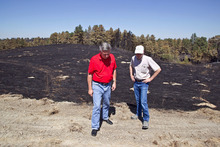 Nebraska Gov. Heineman, left, talks with Scott Josiah, state forester and director of Nebraska Forest Service, as they inspect fire damage at Chadron State Park, Sunday, Sept. 2, 2012, near Chadron, Neb. Officials estimated Sunday that the fires have now burned roughly 273 square miles, including at least 27,000 acres in South Dakota. That's up from roughly 93 square miles on Saturday and more than twice the size of Omaha. (AP Photo/Omaha World-Herald, Jeff Beiermann, Pool)