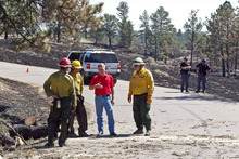Nebraska Gov. Heineman, third from left, talks with a U.S Forest Service fire crew from Arizona who battled the West Ash fire near Chadron, Neb., Sunday, Sept. 2, 2012. Officials estimated Sunday that the fires have now burned roughly 273 square miles, including at least 27,000 acres in South Dakota. That's up from roughly 93 square miles on Saturday and more than twice the size of Omaha. (AP Photo/Omaha World-Herald, Jeff Beiermann, Pool)