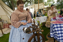 Chris Detrick     The Salt Lake Tribune Tracy Mutter, of Magna, spins wool during Camp Floyd Days at Camp Floyd State Park in Fairfield Saturday September 1, 2012. The event will allow visitors to experience camp life and participate in several activities performed by soldiers of Johnston's Army. Events include reenactments, encampments, stagecoach rides (Monday 12pm – 2pm), firearm and cannon demonstrations, marches, drills, 1861 period games, and photos in period uniform. The events will be conducted 10 a.m. to 4 p.m. on both days. Standard museum entrance fees are $2 per person or $6 per family.