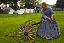 Chris Detrick     The Salt Lake Tribune Jeri Hansen, of Fairfield, loads a replica canon during Camp Floyd Days at Camp Floyd State Park in Fairfield Saturday September 1, 2012. The event will allow visitors to experience camp life and participate in several activities performed by soldiers of Johnston's Army. Events include reenactments, encampments, stagecoach rides (Monday 12pm – 2pm), firearm and cannon demonstrations, marches, drills, 1861 period games, and photos in period uniform. The events will be conducted 10 a.m. to 4 p.m. on both days. Standard museum entrance fees are $2 per person or $6 per family.
