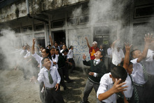 Students from Tibetan school throw barley flour as they attend a program to mark the Tibetan Democracy Day in Katmandu, Nepal, Sunday, Sept. 2, 2012. This day in 1960, members of the first Tibetan parliament-in-exile were elected. (AP Photo/Niranjan Shrestha)