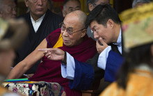 Tibetan spiritual leader the Dalai Lama, left, listens to Lobsang Sangay, the prime minister of the Tibetan government-in-exile during the Tibetan Democracy Day celebrations at the Tsuglakhang temple in Dharmsala, India, Sunday, Sept. 2, 2012. This day in 1960, members of the first Tibetan parliament-in-exile were elected. (AP Photo/Ashwini Bhatia)