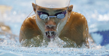 Tomotaro Nakamura of Japan swims in men's 100-meter breaststroke SB7 heats at the 2012 Paralympics games, Saturday, Sept. 1, 2012, in London. (AP Photo/Alastair Grant)