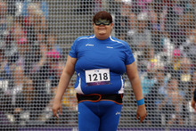 Italy's Assunta Legnante, wears an eye mask with a design, as she waits for her guide to escort her out of the cage after she threw in the women's discus F11/12 category during the athletics competition at the 2012 Paralympics, Saturday, Sept. 1, 2012, in London.  (AP Photo/Matt Dunham)