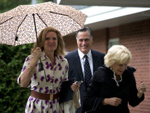 Republican presidential candidate, former Massachusetts Gov. Mitt Romney, center, his wife Ann, left, and Nancy Marriott arrive at the Church of Jesus Christ of Latter-day Saints on Sunday, Sept. 2, 2012 in Wofeboro, N.H.  (AP Photo/Evan Vucci)