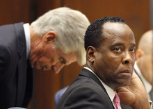 Dr. Conrad Murray sits at the defense table with his attorney J. Michael Flanagan during his trial in the death of pop star Michael Jackson in Los Angeles, Thursday, Oct. 6, 2011. (AP Photo/Mario Anzuoni, Pool)