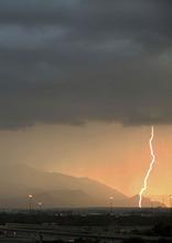 Lennie Mahler  |  The Salt Lake Tribune Lightning strikes west of Salt Lake City over I-15 as the Sun sets Saturday, Sept. 1, 2012.
