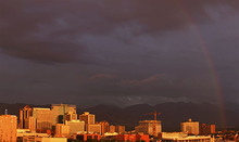 Lennie Mahler  |  The Salt Lake Tribune A rainbow forms during a storm over downtown Salt Lake City at sunset Saturday, Sept. 1, 2012. Note: This is a composite image.