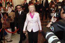 US State Secretary Hillary Rodham Clinton, center, walks with Indonesian Foreign Minister Marty Natalegawa after their meeting in Jakarta, Indonesia, Monday, Sept. 3, 2012. (AP Photo/Dita Alangkara)
