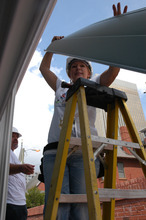 Laura Arellano, from Salt Lake City, participates in a service project at the Democratic National Convention. The delegates helped build a modular home that will be given to a veteran. Photo by Leah Bryner.