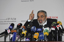Syrian Information Minister Omran al-Zoebi speaks during a press conference in Damascus, Syria, Monday, September 3, 2012. Al-Zoebi vowed that Syria will give the new U.N. envoy, Lakhdar Brahimi,