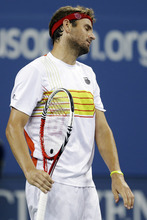 Mardy Fish reacts after missing a shot during a match against Gilles Simon, of France, at the U.S. Open tennis tournament, Saturday, Sept. 1, 2012, in New York. (AP Photo/Darron Cummings)