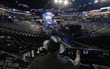 Lt. A.C. Powers of Augusta County Sheriff's from Stanton, Va., looks down on the floor in Time Warner Cable Arena at the Democratic National Convention in Charlotte, N.C., on Monday, Sept. 3, 2012. (AP Photo/David Goldman)