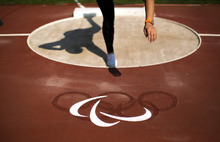 China's Juan Yao competes before wining the women's shot put F42/44 final at the 2012 Paralympics in London, Monday, Sept. 3, 2012. (AP Photo/Emilio Morenatti)