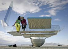 Rick Egan  |  The Salt Lake Tribune  Randall Leeds and Elise Fande, of San Francisco, share a kiss on the Cosmic Carousel at Burning Man, the annual arts festival in the Black Rock Desert in Nevada.