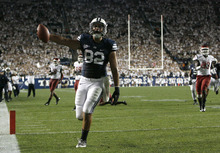 Chris Detrick  |  The Salt Lake Tribune Brigham Young Cougars tight end Kaneakua Friel (82) scores a touchdown during the first half of the game against Washington State at LaVell Edwards Stadium in Provo on Thursday, Aug. 30, 2012.
