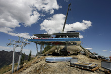 Rick Egan  | The Salt Lake Tribune  A crane lifts pieces into place for the new Little Cloud chairlift at Snowbird Ski & Summer Resort. The high-speed quad lift will replace a 32-year-old fixed-grip two-seater and will feature a 90-degree turn at the ridgetop unloading station, capable of dispersing riders in three directions.