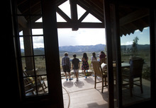Kim Raff |  The Salt Lake Tribune People walk on the patio of the 4,500-square-foot home on Dakota Trail in the Promontory during the Park City Showcase of Homes on September 2, 2012.